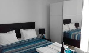 A bed or beds in a room at Tavira Great Suite with Pool