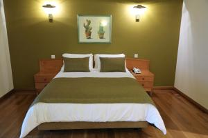 A bed or beds in a room at Eira do Serrado - Hotel & Spa