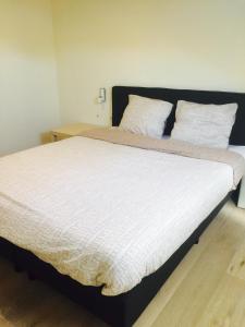 Un ou plusieurs lits dans un hébergement de l'établissement Vakantiestudio Melroce
