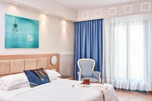Кровать или кровати в номере Lagos Mare Hotel