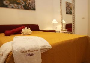 A bed or beds in a room at Casa vacanze Diletta