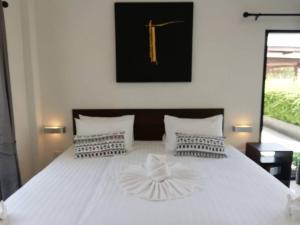 Ein Bett oder Betten in einem Zimmer der Unterkunft Limelight Village