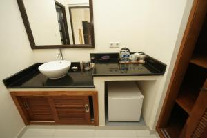 Een badkamer bij Swastika Bungalows