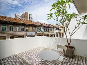Un balcón o terraza de Hutton Central Hotel By PHC