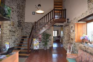 El vestíbulo o zona de recepción de Pensión Albergue Los Caminantes