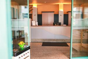 The lobby or reception area at PLAZA Hotel Bruchsal