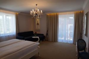 Łóżko lub łóżka w pokoju w obiekcie Moris Boutique Beach Hotel