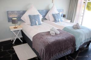 A bed or beds in a room at Southern Cross Guesthouse