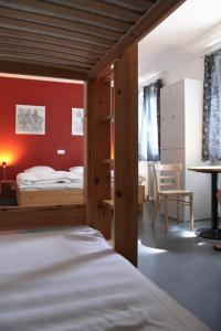 Ein Bett oder Betten in einem Zimmer der Unterkunft Babelfish Hostel