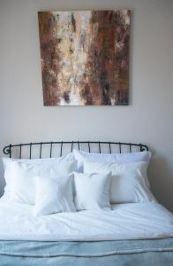 Кровать или кровати в номере Apartment on Bolshoy Prospekt