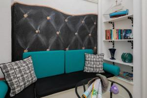A seating area at PLR Luxury Rooms