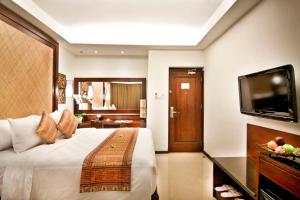 A television and/or entertainment center at Best Western Kuta Villa