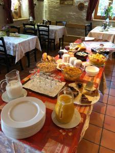 Restaurant ou autre lieu de restauration dans l'établissement Auberge de la Réunion