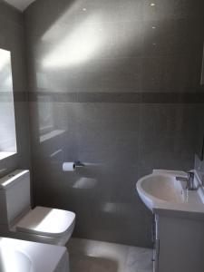 A bathroom at Rushden Vacation Home
