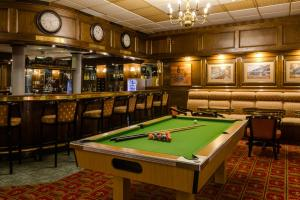 A billiards table at Protea Hotel by Marriott George King George