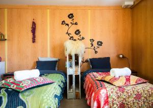 A bed or beds in a room at Ytra Lón Farm Lodge