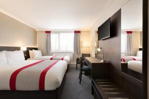 A bed or beds in a room at Ramada Chorley South