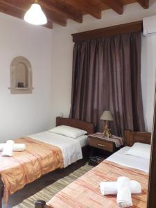Кровать или кровати в номере Villa Polymnia