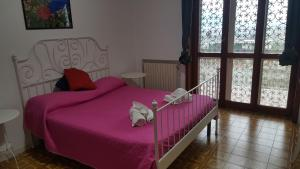 A bed or beds in a room at Le ginestre