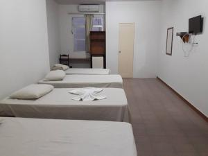 A bed or beds in a room at Hotel Danubio