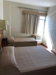 A bed or beds in a room at Hotel Globo Rio