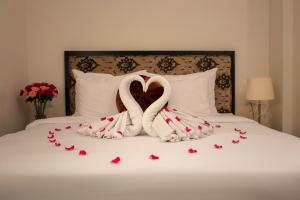 A bed or beds in a room at Serenity Diamond Hotel