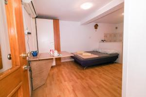 A bed or beds in a room at Fri Apartment