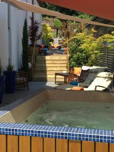 The swimming pool at or near Hotel Restaurant Au Cheval Blanc