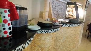 A kitchen or kitchenette at Hotel Privilege