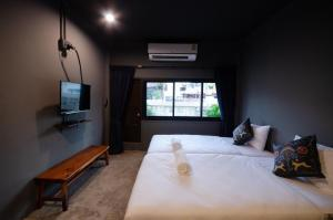 A bed or beds in a room at Tian Tian Hostel
