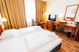 Ein Bett oder Betten in einem Zimmer der Unterkunft Hotel Excelsior - Central Station