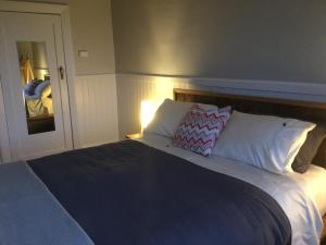 A bed or beds in a room at The Station House