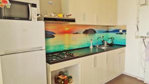 Кухня или мини-кухня в Дом для отдыха Олимпийский парк