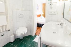 Ein Badezimmer in der Unterkunft Hotel Excelsior - Central Station