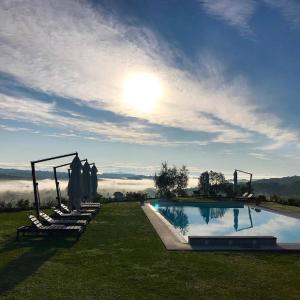 The swimming pool at or close to Villa il Castagno Wine & Resort