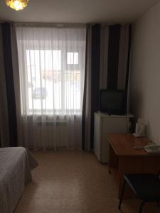 Телевизор и/или развлекательный центр в Отель Лада