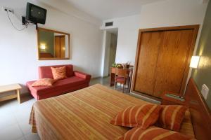 Cama o camas de una habitación en Hotel Joya