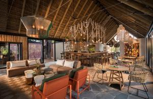 Salon ou bar de l'établissement Lion Sands River Lodge