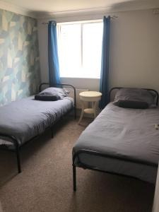 A bed or beds in a room at Beautiful Byewaters sleeps 5 free parking