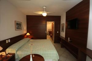 A bed or beds in a room at Hotel 7 Colinas