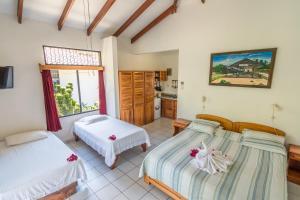 Кровать или кровати в номере Hotel Colinas del Sol