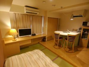 A television and/or entertainment center at Osaka Hana Hostel