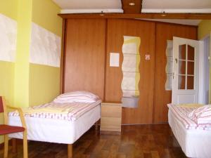 Łóżko lub łóżka w pokoju w obiekcie Pokoje Gościnne Irene