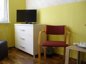 Telewizja i/lub zestaw kina domowego w obiekcie Pokoje Gościnne Irene