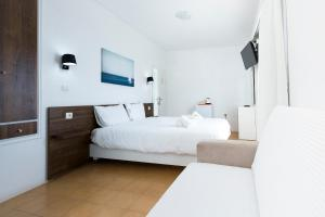 A bed or beds in a room at Kissamia Rooms