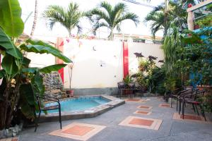The swimming pool at or near Dreamkapture Hostel