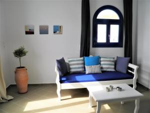 A seating area at Santorini Traditional Suites