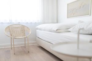 Ein Bett oder Betten in einem Zimmer der Unterkunft Ferien Domizil 25
