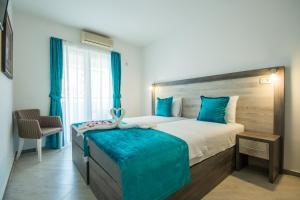Кровать или кровати в номере Villa Giardino