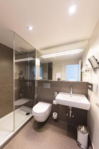 Ein Badezimmer in der Unterkunft Hotel Lavaux